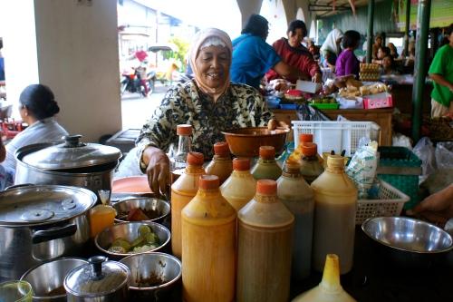 A traditional homemade jamu seller in Pasar Pujokusuman, Yogyakarta