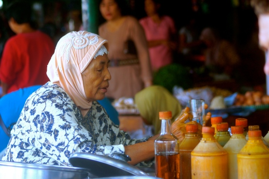 A traditional homade jamu seller was making a glass of galian rapat, which is believed to tighten vagina