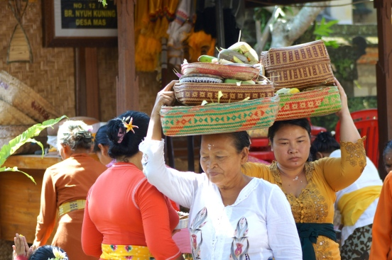Balinese women were carrying offering to the temple on Galungan day. [2013: E O]